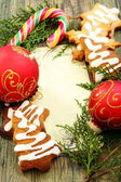 Christmas balls, gingerbread and candy cane. — Foto de Stock