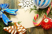 Christmas card with balls, candy and snowflakes. — Stock Photo
