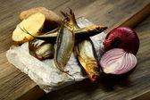 Smoked fish, potatoes and red onion. — Stock Photo