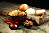 Spoon and bowl of buckwheat. — Stock Photo
