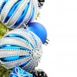 Stock Photo: Christmas card with blue balls and cones.