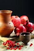 Ceramic jug, pomegranate and juice in cup . — ストック写真