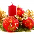 Stock Photo: Christmas balls, candles and pine cones.