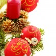 Christmas composition with red balls and candles. — Stock Photo