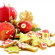 Stock Photo: Christmas cookies, red balls and golden cones.