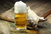 Glass with beer and dried fish. — Stock Photo