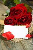 Red hearts, postcard and roses. — Stock Photo