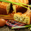 Stock Photo: Pie stuffed with eggs and onion closeup.