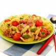 Pasta with bacon, tomatoes and basil. - Stock Photo