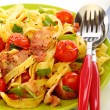 Pasta with bacon, tomatoes and basil. — Stock Photo