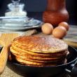 Pancakes and eggs on a black background. — Stok fotoğraf