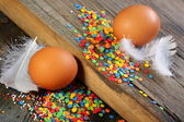 Eggs, feathers and Easter decorations. — Stock Photo