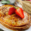 Pancakes with honey sauce. - Stock Photo