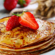 Pancakes with honey and strawberries. — Stock Photo