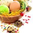 Easter eggs in a bowl on old wooden. — Stock Photo