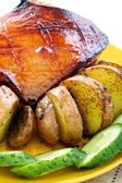 Pork belly in an orange glaze with roasted potatoes. — Stock Photo