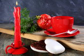 Gingerbread, candle and Christmas ball. — Stock Photo