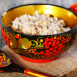Stock Photo: Pearl barley porridge in colorful bowl.