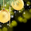 Stock Photo: Pine branch with golden Christmas balls.