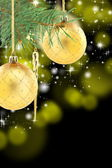 Pine branch with golden Christmas balls. — Stock Photo