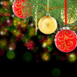 Red and gold christmas balls on spruce branch. — Stock Photo
