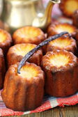 Small French cakes Canele and vanilla. — Stock fotografie