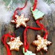 Christmas cookies and spruce branches in the snow. — Stock Photo #37606069