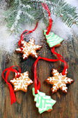 Christmas cookies and spruce branches in the snow. — Stock Photo