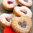 图库照片: Linzer Cookie and red heart.