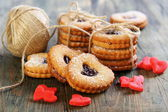Red marzipan hearts, cookies and ball of twine. — Stock Photo