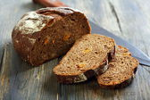 Rye bread with dried apricots and nuts. — Stock Photo