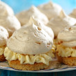 Meringue cakes with cream. — Stock Photo