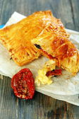 Puff pastry with cheese and sun-dried tomato. — Stock Photo