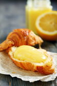 Croissant with lemon cream. — Stock Photo