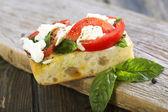 Tomatoes, mozzarella and basil on ciabatta. — ストック写真