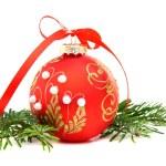 Christmas ball and a pine branch. — Stock Photo #7990236