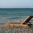 Wooden chair on the beach — Stock Photo