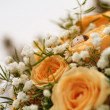 Gold ring on a bouquet of roses — Stock Photo
