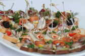 Canapes with skewers and sandwiches — Stock Photo