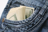 Dollars in the pocket of jeans — Стоковое фото