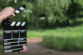 Clapperboard in hands  — Stockfoto