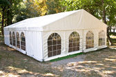 White big tent in forest — Stock Photo
