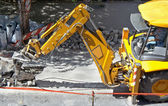 Heavy machine during a road construction work — Stock Photo