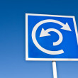 Roundabout sign over blue sky — Stock Photo