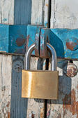 Padlock and chain on old wooden door — Stock Photo