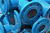 Blue iron pipes as background — Stock Photo