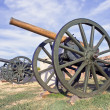 Old cannons on fortress over blue sky - Stock Photo