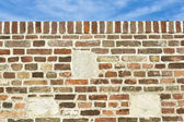 Brick wall and sky as background — Stock Photo