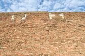 Fortress brick wall and sky as background — Stock Photo