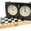 Old chess clock on chessboard — 图库照片